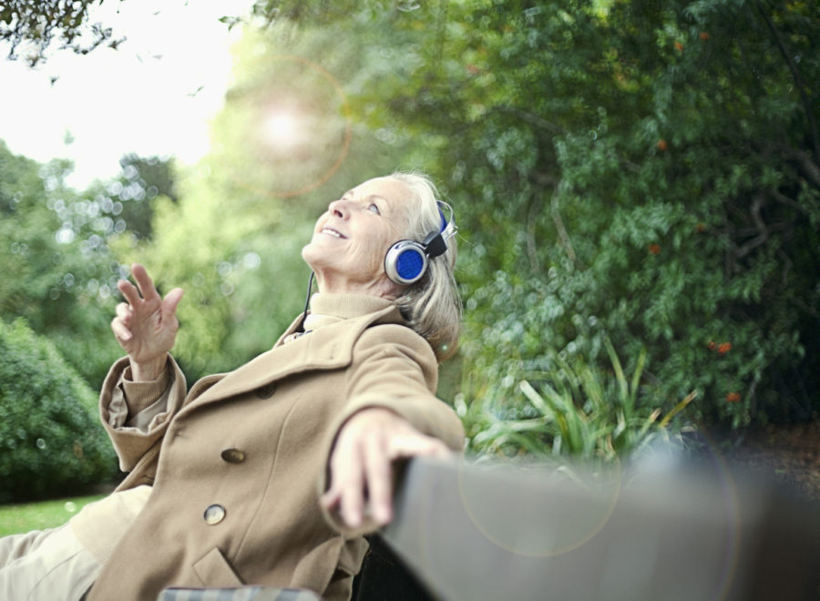 Woman Listening to Music with Earphones